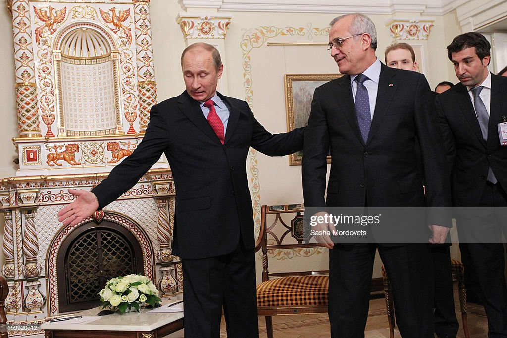 President <a gi-track='captionPersonalityLinkClicked' href=/galleries/search?phrase=Vladimir+Putin&family=editorial&specificpeople=154896 ng-click='$event.stopPropagation()'>Vladimir Putin</a> (R) greets Lebanese President Michel Suleiman on January, 23, 2013 in Moscow, Russia. The two leaders planned to discuss proposed closer Russian-Lebanese economic and cultural relations and the situation in the Middle East.