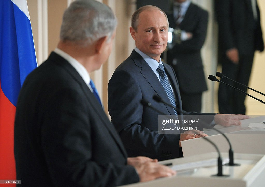 President Vladimir Putin (R) looks at Israeli Prime Minister Benjamin Netanyahu as they attend a joint press conference after their meeting at Putin's residence in the Black Sea resort of Sochi, on May 14, 2013. Putin warned today against any moves that would further destabilise the situation in Syria, speaking after talks with the visiting Israeli Prime Minister.