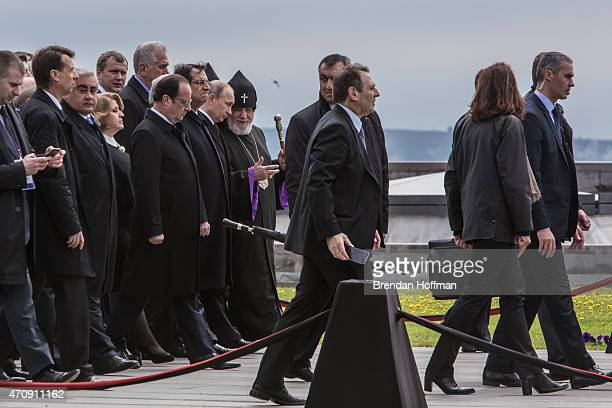 President Vladimir Putin of Russia President Francois Hollande of France and other officials depart after a commemoration ceremony at the Armenian...