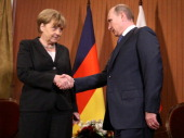 President Vladimir Putin of Russia shakes hands with Chancellor Angela Merkel of Germany during their meeting in the Barriere Normandy Hotel on June...