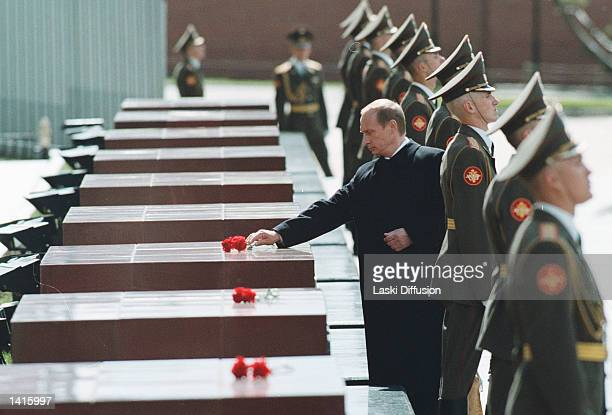 President Vladimir Putin sets a flower on a tomb during the ceremony his inauguration May 7 2000 in the Kremlin Moscow During a ceremony that evoked...