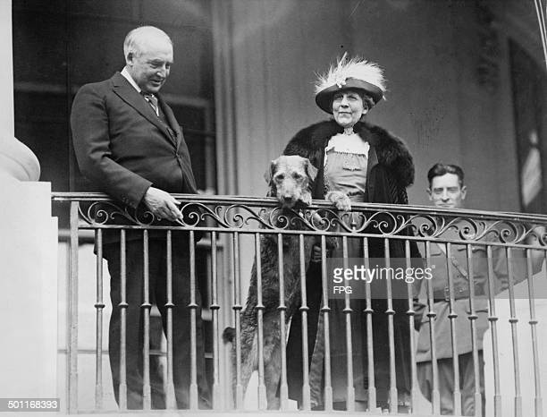 US President Warren G Harding and First Lady Florence Harding watch from a balcony as an annual Easter Monday children's eggrolling event takes place...
