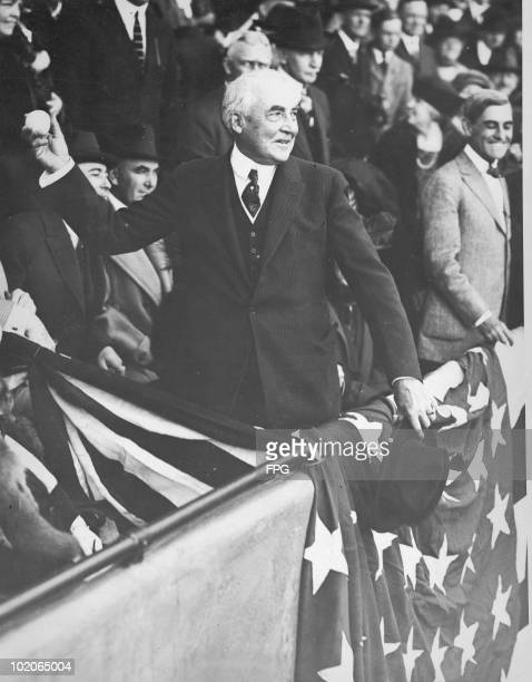 US President Warren G Harding throws the first ball at the opening of the baseball season in Washington DC circa 1922