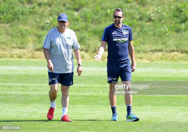 president Werner Gegenbauer and CEO Michael Preetz of Hertha BSC chat during the training camp on august 2 2017 in Schladming Austria