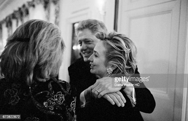 President William Clinton and First Lady Hillary Rodham Clinton are photographed with Eunice Shriver on their way to a dinner in the White House...