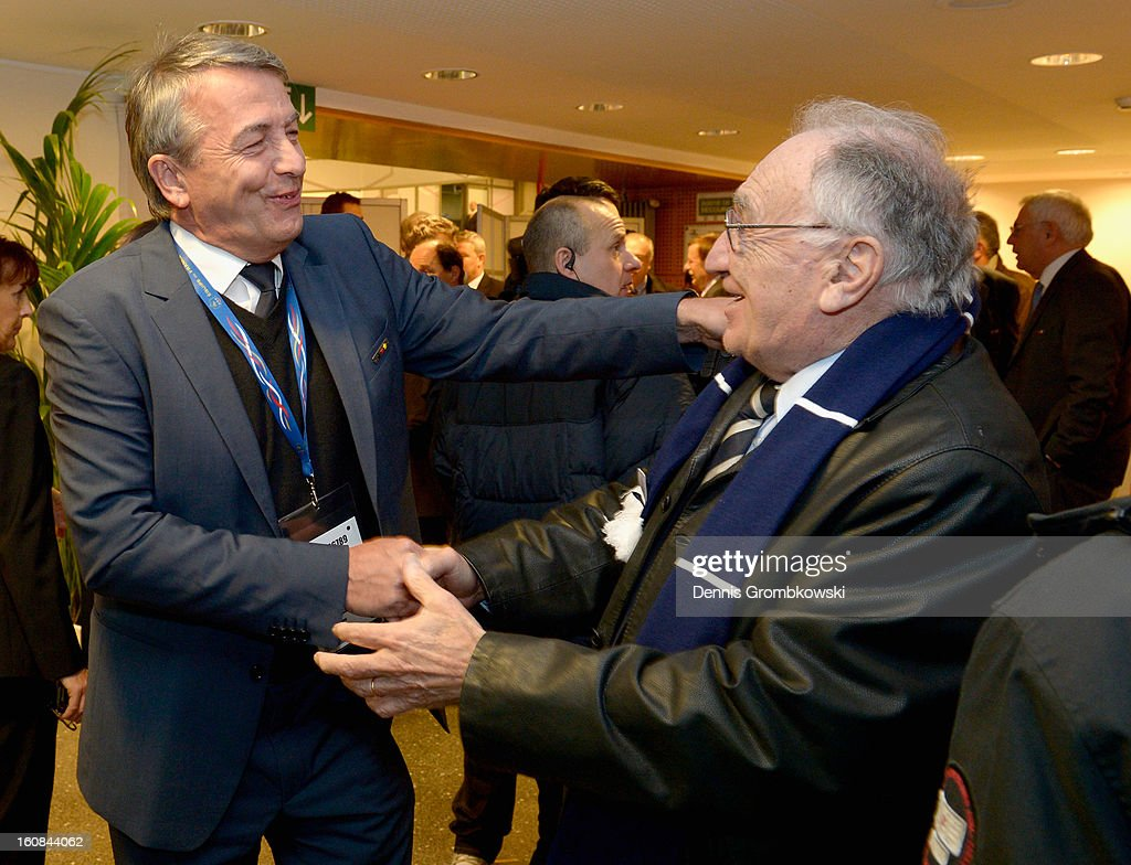 DFB president <a gi-track='captionPersonalityLinkClicked' href=/galleries/search?phrase=Wolfgang+Niersbach&family=editorial&specificpeople=555796 ng-click='$event.stopPropagation()'>Wolfgang Niersbach</a> and former FFF president Jean-Pierre Escalette shake hands during a meeting of the 1982 World Cup teams of France and Germany on February 6, 2013 in Paris, France.