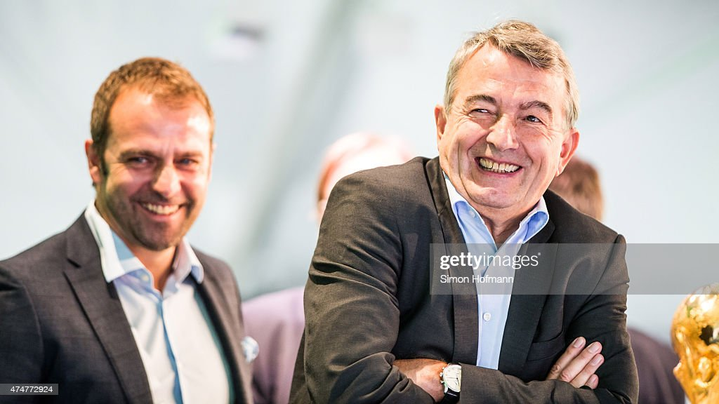 President <a gi-track='captionPersonalityLinkClicked' href=/galleries/search?phrase=Wolfgang+Niersbach&family=editorial&specificpeople=555796 ng-click='$event.stopPropagation()'>Wolfgang Niersbach</a> and Hansi Flick (L) smile during the DFB Ehrenrunde Kick-Off event on May 26, 2015 in Frankfurt am Main, Germany.