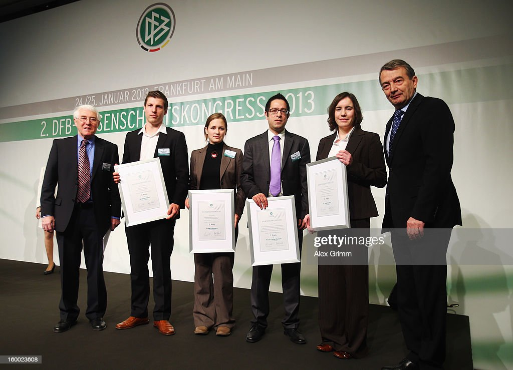 DFB president Wolfgang Niersbach (R) and Martin-Peter Buech (L), head of the DFB Science department, pose with the DFB Science Award winners Georg Froese, Marie Kronberg, Stefan Chatrath and Julia Franke (2L-2R) during the DFB Science Congress 2013 at the Steigenberger Airport Hotel on January 25, 2013 in Frankfurt am Main, Germany.