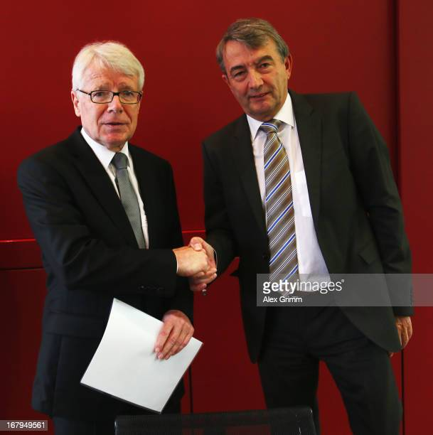 President Wolfgang Niersbach and Reinhard Rauball President of the German League Association shake hands after a press conference following a DFB...