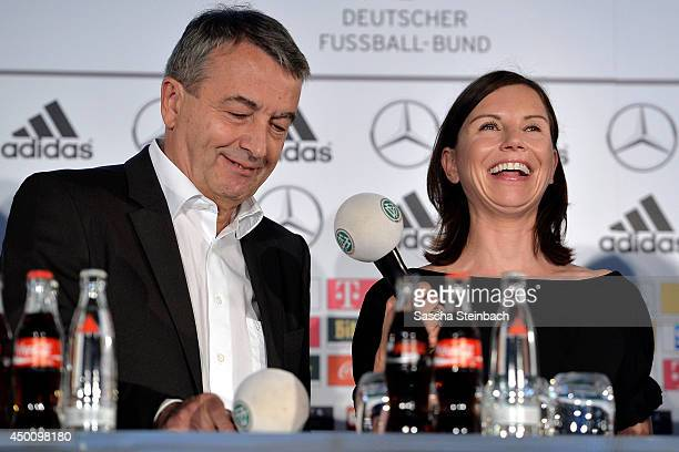 DFB President Wolfgang Niersbach and Teresa Enke wife of former goalkeeper Robert Enke and head of the Robert Enke foundation react during social...