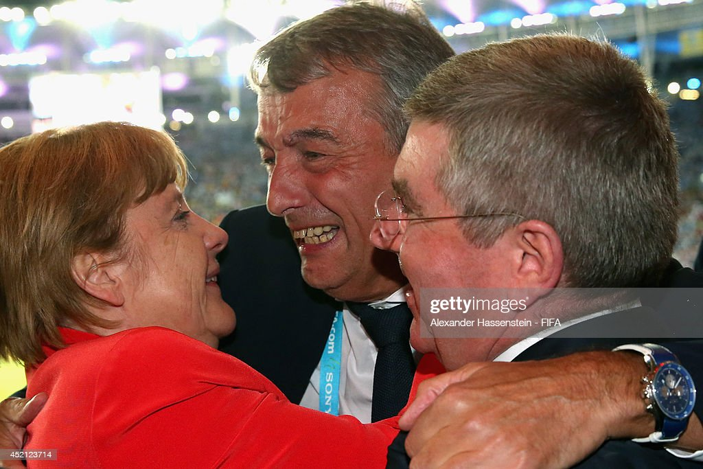 President Wolfgang Niersbach (C) celebrate winning the World Cup with German Chancellor Angela Merkel and IOC President Thomas Bach after the 2014 FIFA World Cup Brazil Final match between Germany and Argentina at Maracana on July 13, 2014 in Rio de Janeiro, Brazil.