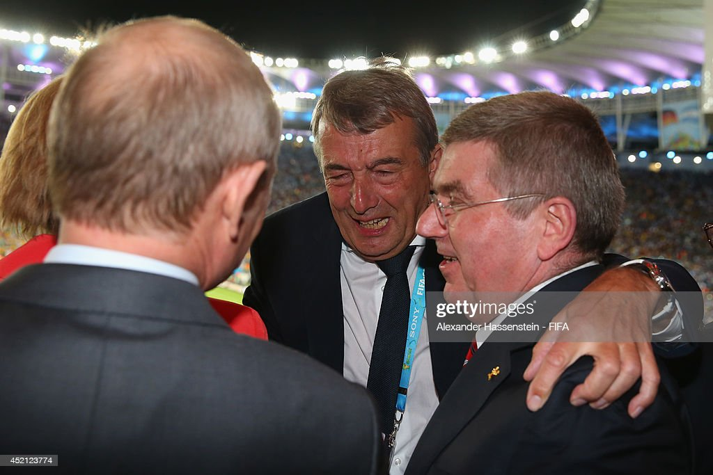 President Wolfgang Niersbach (2nd R) celebrate winning the World Cup with German Chancellor Angela Merkel, Russian President Vladimir Putin (L) and IOC President Thomas Bach (R) after the 2014 FIFA World Cup Brazil Final match between Germany and Argentina at Maracana on July 13, 2014 in Rio de Janeiro, Brazil.