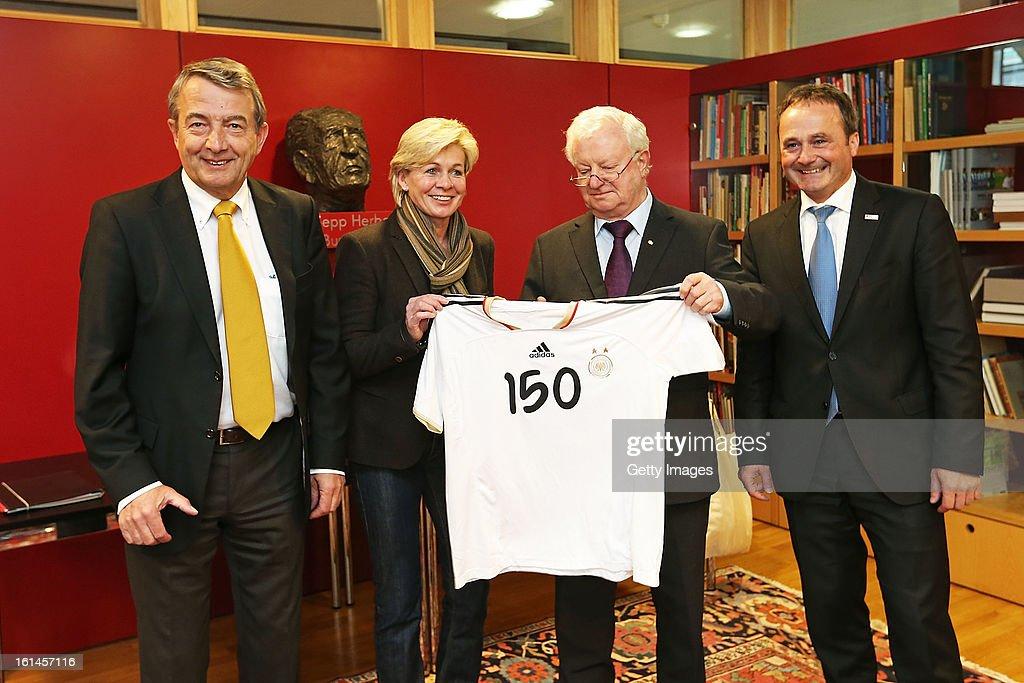 DFB president <a gi-track='captionPersonalityLinkClicked' href=/galleries/search?phrase=Wolfgang+Niersbach&family=editorial&specificpeople=555796 ng-click='$event.stopPropagation()'>Wolfgang Niersbach</a>, <a gi-track='captionPersonalityLinkClicked' href=/galleries/search?phrase=Silvia+Neid&family=editorial&specificpeople=641230 ng-click='$event.stopPropagation()'>Silvia Neid</a>, head coach of the German women's national football team, DRK president Dr. Rudolf Seiters and Bernd Schmitz of the DRK are posing with a DFB jersey on February 11, 2013 in Frankfurt am Main, Germany.