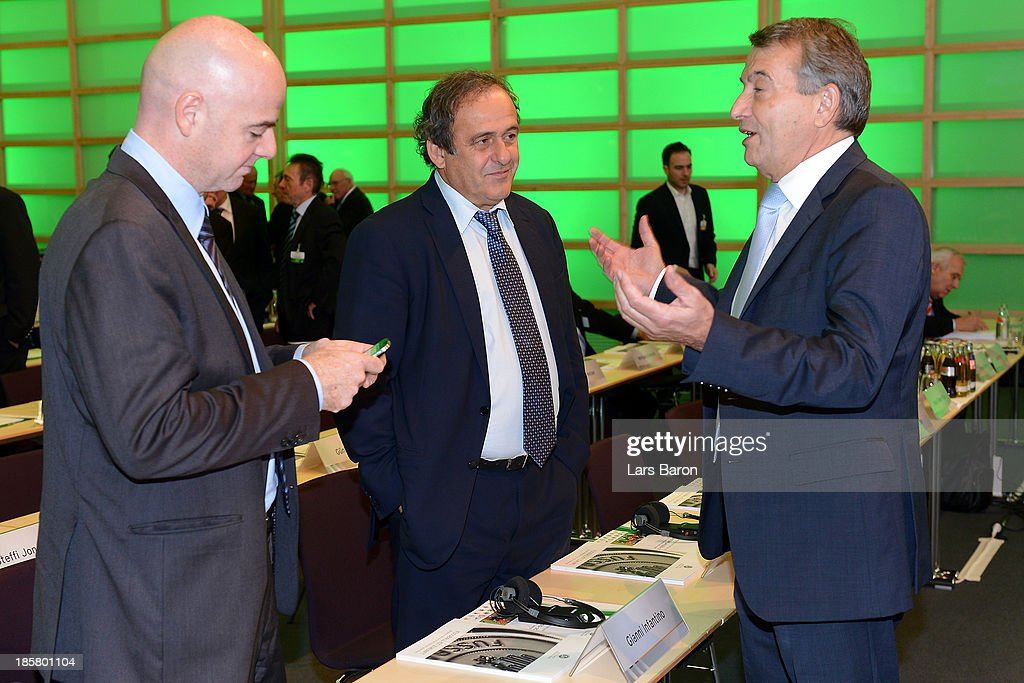 DFB president <a gi-track='captionPersonalityLinkClicked' href=/galleries/search?phrase=Wolfgang+Niersbach&family=editorial&specificpeople=555796 ng-click='$event.stopPropagation()'>Wolfgang Niersbach</a> talks to UEFA president <a gi-track='captionPersonalityLinkClicked' href=/galleries/search?phrase=Michel+Platini&family=editorial&specificpeople=206862 ng-click='$event.stopPropagation()'>Michel Platini</a> and UEFA general secretary Giovanni Infantino during the DFB Bundestag at NCC Nuremberg on October 25, 2013 in Nuremberg, Germany.