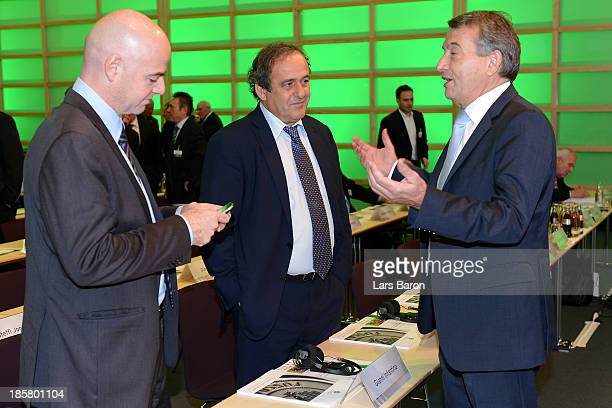 DFB president Wolfgang Niersbach talks to UEFA president Michel Platini and UEFA general secretary Giovanni Infantino during the DFB Bundestag at NCC...