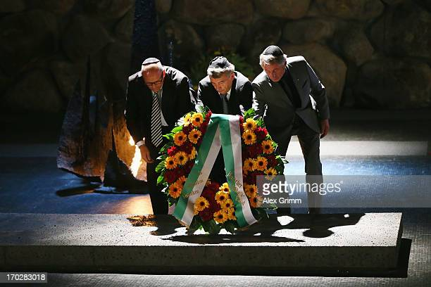 President Wolfgang Niersbach Vice President Rolf Hocke and the German ambassador in Israel Andreas Michaelis lay a wreath during a visit of the...