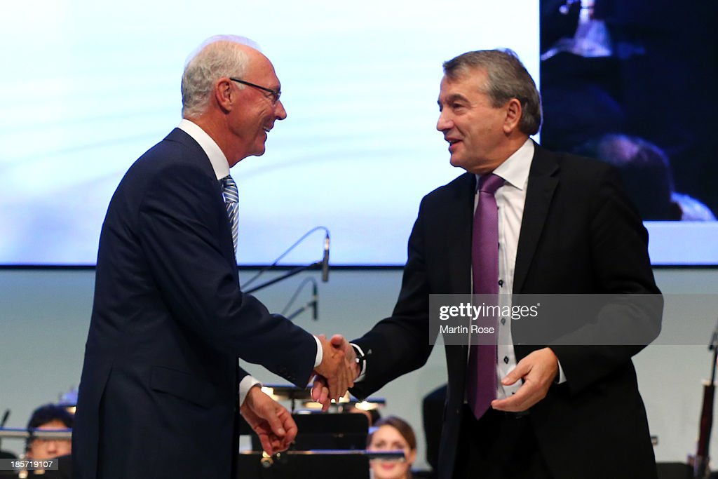 DFB president <a gi-track='captionPersonalityLinkClicked' href=/galleries/search?phrase=Wolfgang+Niersbach&family=editorial&specificpeople=555796 ng-click='$event.stopPropagation()'>Wolfgang Niersbach</a> (r) welcomes DFB honor team captain <a gi-track='captionPersonalityLinkClicked' href=/galleries/search?phrase=Franz+Beckenbauer&family=editorial&specificpeople=210545 ng-click='$event.stopPropagation()'>Franz Beckenbauer</a> during the DFB Bundestag at the NCC Nuremberg on October 24, 2013 in Nuremberg, Germany.