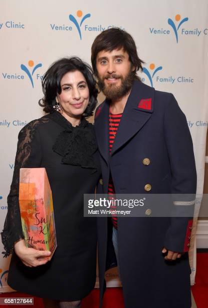 President Worldwide Marketing Distribution Warner Bros Pictures Sue Kroll and actor Jared Leto pose backstage with the Humanitarian Award at the...