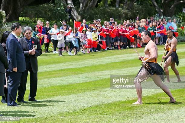President Xi Jinping Of China looks on as a Maori warrior performs a Wero during a State Welcome at Government House on November 20 2014 in...