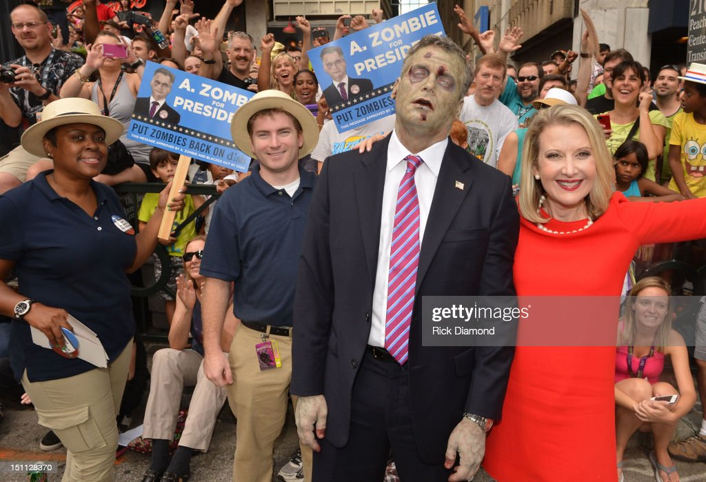 Presidentail Candidate A. Zombie and his human wife Patty Morgan-Zombie attend The Dragon*Con Parade 2012 on Sweet Auburn Avenue on September 1, 2012 in Atlanta, Georgia.