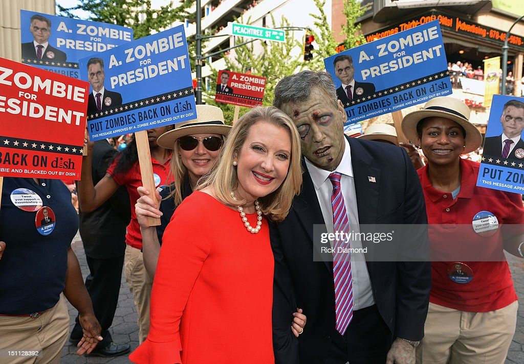 Presidentail Candidate A. Zombie (right) and his human wife Patty Morgan-Zombie attend The Dragon*Con Parade 2012 on Sweet Auburn Avenue on September 1, 2012 in Atlanta, Georgia.