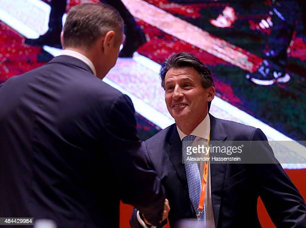 IAAF presidental candidates Lord Sebastian Coe and Sergey Bubka shake hands before the start of the 50th IAAF Congress at the China National...