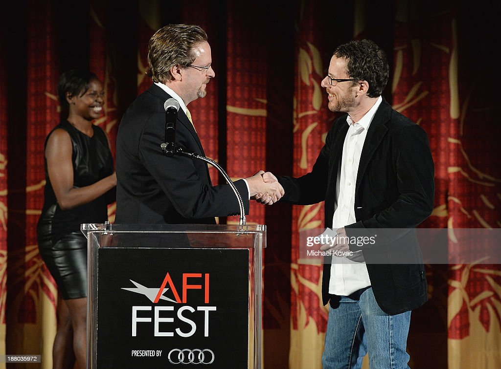 President/CEO Bob Gazzale (L) and writer/director Ethan Coen introduce the AFI FEST 2013 presented by Audi closing night gala screening of 'Inside Llewyn Davis' at TCL Chinese Theatre on November 14, 2013 in Hollywood, California.