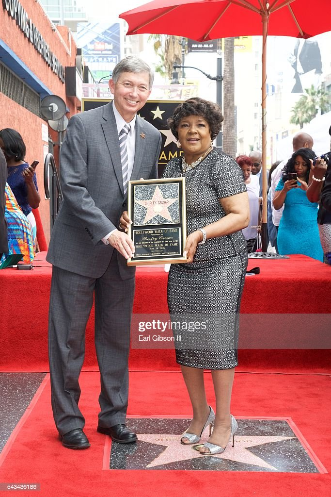 President/CEO Hollywood Chamber Of Commerce Leon Gubler and Gospel Recording Artist <a gi-track='captionPersonalityLinkClicked' href=/galleries/search?phrase=Shirley+Caesar&family=editorial&specificpeople=828879 ng-click='$event.stopPropagation()'>Shirley Caesar</a> hold the commemorative plaque as <a gi-track='captionPersonalityLinkClicked' href=/galleries/search?phrase=Shirley+Caesar&family=editorial&specificpeople=828879 ng-click='$event.stopPropagation()'>Shirley Caesar</a> is Honored with a Star On The Hollywood Walk Of Fame on June 28, 2016 in Hollywood, California.