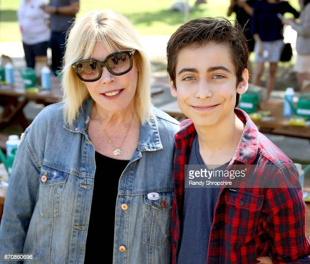 President/CEO of EMA Debbie Levin and actor Aidan Gallagher attend Caruso hosts a community garden in honor of Earth Day in partnership with...