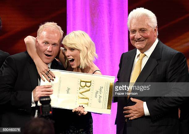 President/CEO of Sony/ATV Music Publishing Nashville Troy Tomlinson honoree Taylor Swift and Sony/ATV CEO Martin Bandier pose with award onstage at...