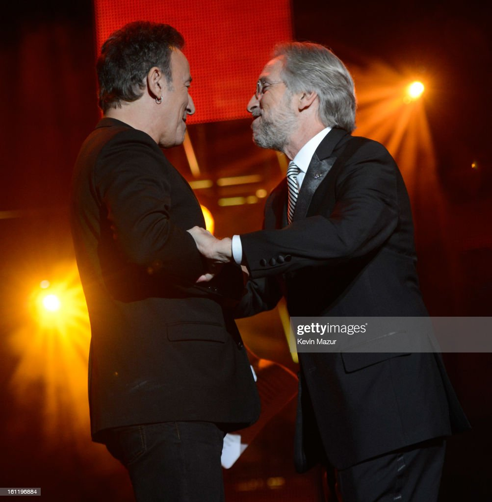 President/CEO of the MusiCares Foundation and The Recording Academy Neil Portnow presents award to Bruce Springsteen onstage at MusiCares Person Of The Year Honoring Bruce Springsteen at Los Angeles Convention Center on February 8, 2013 in Los Angeles, California.