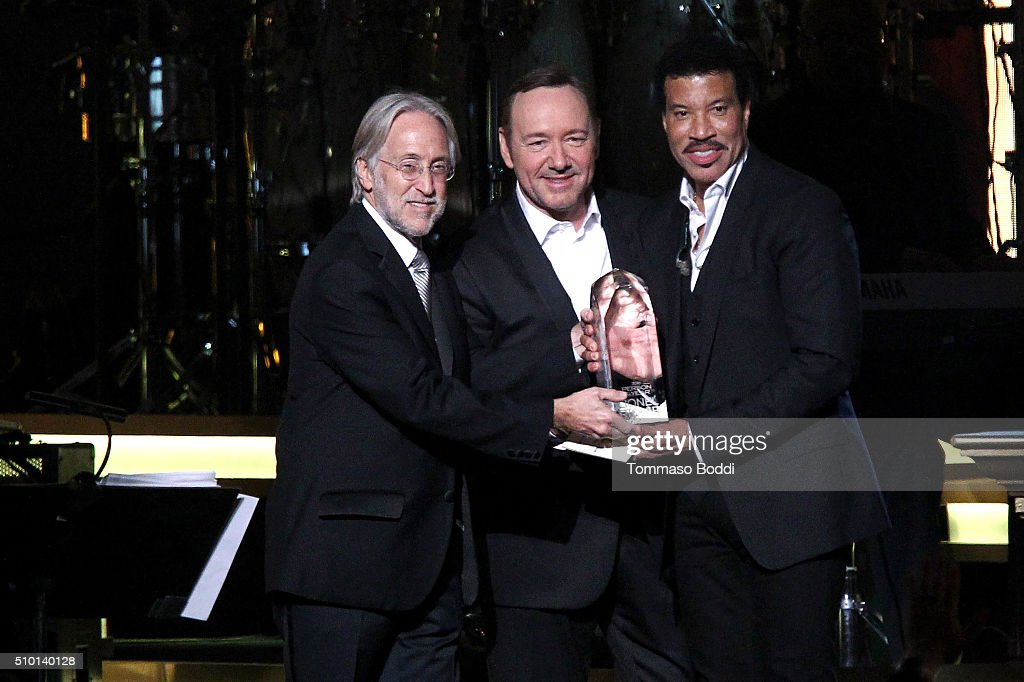 President/CEO of The Recording Academy and GRAMMY Foundation Neil Portnow and actor Kevin Spacey honor singer Lionel Richie on stage during the 2016...