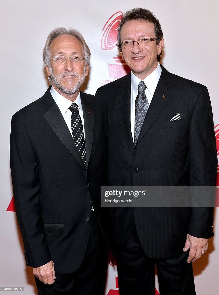President/CEO of The Recording Academy and GRAMMY Foundation President/CEO Neil Portnow (L) and President/CEO of The Latin Recording Academy Gabriel Abaroa Jr. attend the 2014 Person of the Year honoring Joan Manuel Serrat at the Mandalay Bay Events Center on November 19, 2014 in Las Vegas, Nevada.