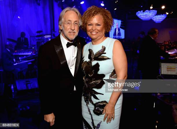President/CEO of The Recording Academy and GRAMMY Foundation President/CEO Neil Portnow and honoree Debra L Lee pose onstage at PreGRAMMY Gala and...