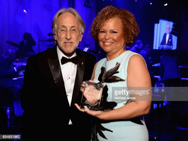 President/CEO of The Recording Academy and GRAMMY Foundation President/CEO Neil Portnow and honoree Debra L Lee holding the President's Merit Award...