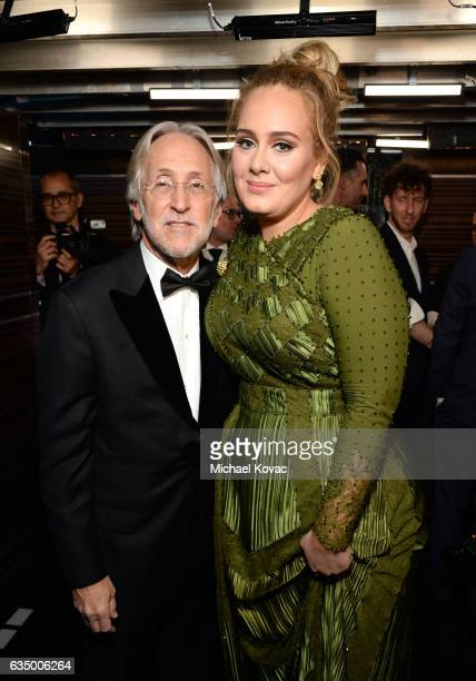 President/CEO of The Recording Academy and GRAMMY Foundation President/CEO Neil Portnow and recording artist Adele pose backstage during during the...