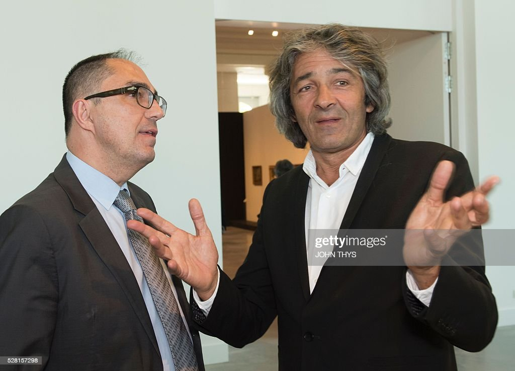 President-Director of the Louvre Jean-Luc Martinez (L) talks with French Architect Rudy Ricciotti during the inauguration of the La Boverie museum, in partnership with Le Louvre, on May 4, 2016 in Liege. / AFP / JOHN