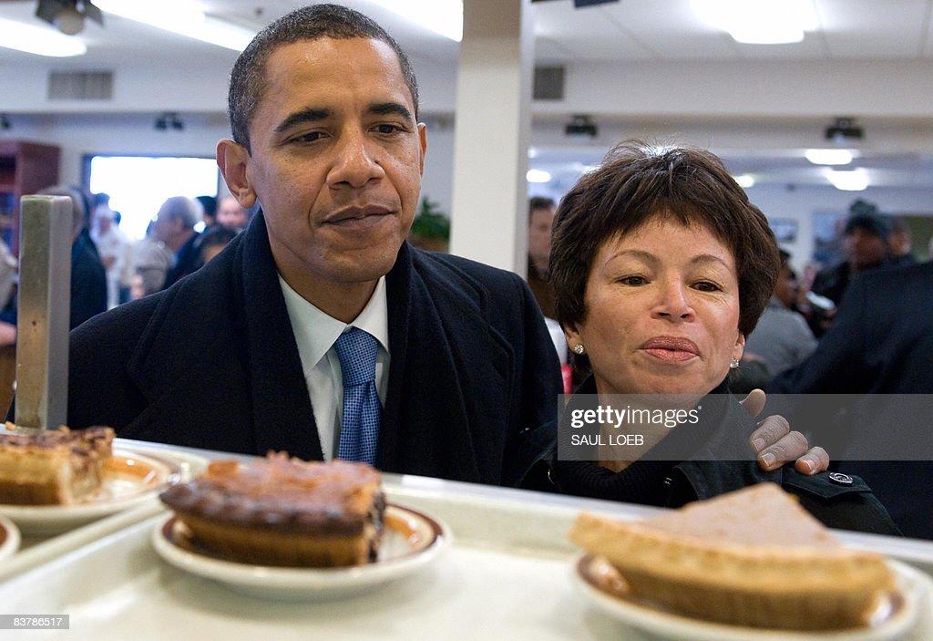 US Presidentelect Barack Obama alongside senior advisor Valerie Jarrett looks at slices of pie while ordering lunch at Manny's Coffee Shop and Deli...