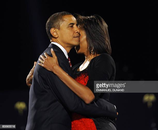 US presidentelect Barack Obama and his wife Michelle embrace on stage during their election night victory rally at Grant Park on November 4 2008 in...