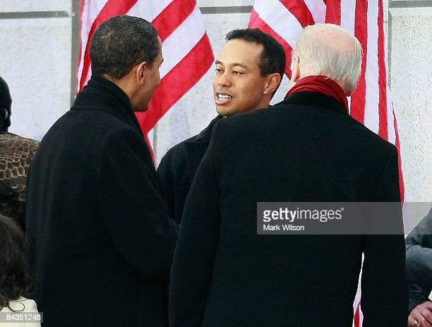 S Presidentelect Barack Obama and Vice Presidentelect Joseph Biden meet golfer Tiger Woods during the 'We Are One The Obama Inaugural Celebration at...