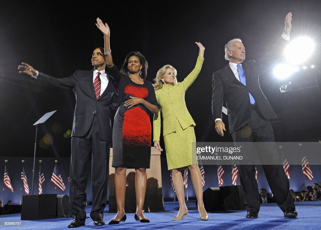 President-elect Barack Obama (L) and wife Michelle, flanked by Vice-President elect Joe Biden (R) and wife Jill wave to the crowd following Obama's victory speech at his election party in Chicago, Illinois, on November 4, 2008.