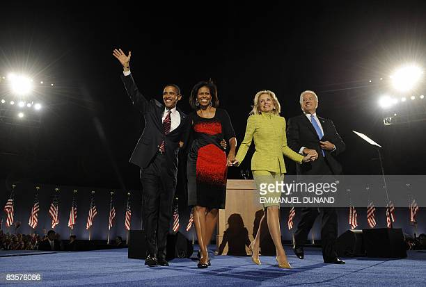 US Presidentelect Barack Obama his wife Michelle stands on stage with Vice Presidentelect Joe Biden and his wife Jill during their election night...