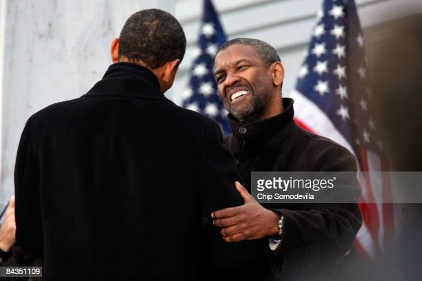 S Presidentelect Barack Obama hugs actor Denzel Washington in front of the Lincoln Memorial during the 'We Are One The Obama Inaugural Celebration At...