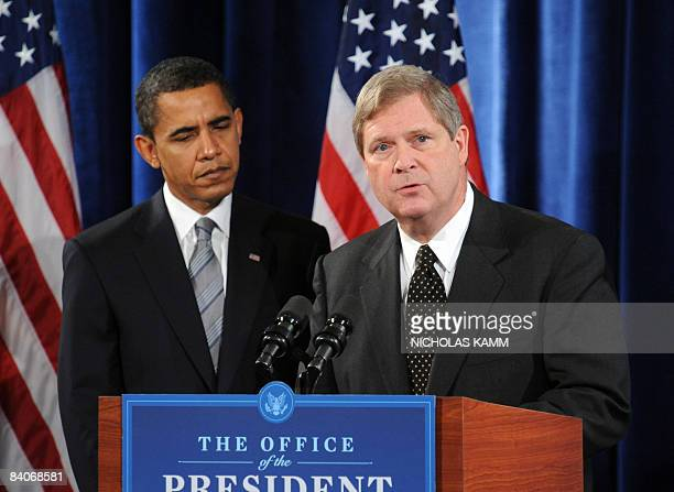 US presidentelect Barack Obama listens as agriculture secretary nominee Tom Vilsack speaks during a press conference in Chicago on December 17 2008...