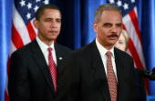 Presidentelect Barack Obama listens to attorney generalselect Eric Holder at a press conference at the Hilton Hotel December 01 2008 in Chicago...
