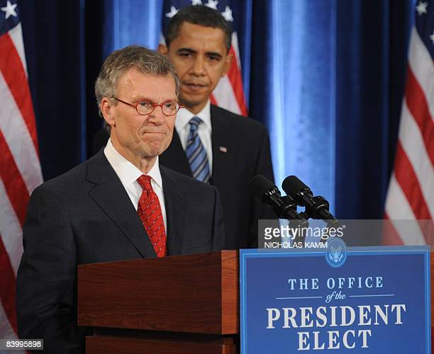 US presidentelect Barack Obama listens to his nominee for Health and Human Services former Sen Tom Daschle during a press conference in Chicago on...