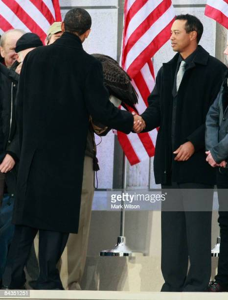 S Presidentelect Barack Obama shakes hands with golfer Tiger Woods during the 'We Are One The Obama Inaugural Celebration at The Lincoln Memorial'...