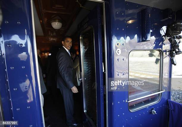 US Presidentelect Barack Obama steps back into the train after waving to wellwishers from the viewing deck of their train as they pass through...