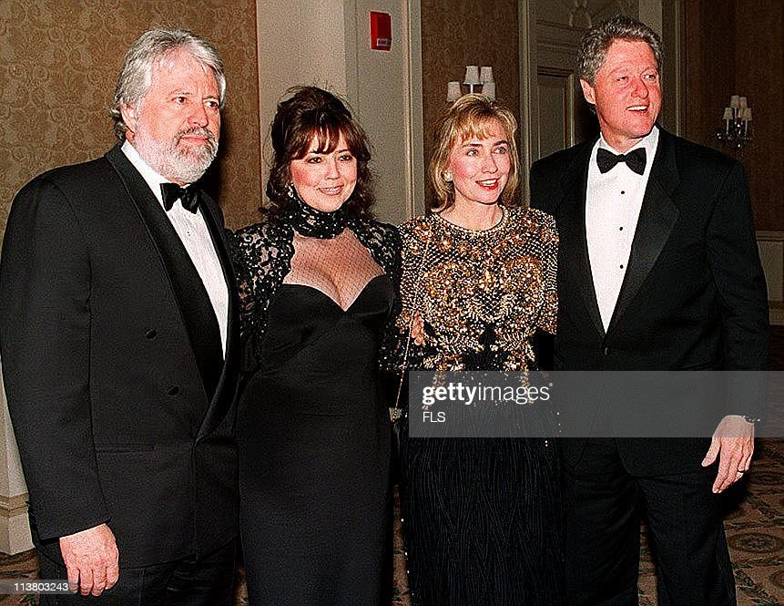 President-elect Bill and Hillary Clinton (R and 2nd R) are seen with television producer Harry Thomason and his wife Linda Bloodworth-Thomason at a private party in this file photo taken 28 November 1992.