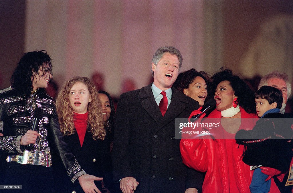 US President-elect <a gi-track='captionPersonalityLinkClicked' href=/galleries/search?phrase=Bill+Clinton&family=editorial&specificpeople=67203 ng-click='$event.stopPropagation()'>Bill Clinton</a> (2ndR) and his daughter chelsea (2ndL) join singers <a gi-track='captionPersonalityLinkClicked' href=/galleries/search?phrase=Michael+Jackson&family=editorial&specificpeople=70011 ng-click='$event.stopPropagation()'>Michael Jackson</a> (L) and <a gi-track='captionPersonalityLinkClicked' href=/galleries/search?phrase=Diana+Ross&family=editorial&specificpeople=202836 ng-click='$event.stopPropagation()'>Diana Ross</a> (R) in the song 'We are the world' on January 17, 1993 at the Lincoln Memorial on the Washington Mall. <a gi-track='captionPersonalityLinkClicked' href=/galleries/search?phrase=Michael+Jackson&family=editorial&specificpeople=70011 ng-click='$event.stopPropagation()'>Michael Jackson</a> died on June 25, 2009 after suffering a cardiac arrest, sending shockwaves sweeping across the world and tributes pouring in on June 26 for the tortured music icon revered as the 'King of Pop.'